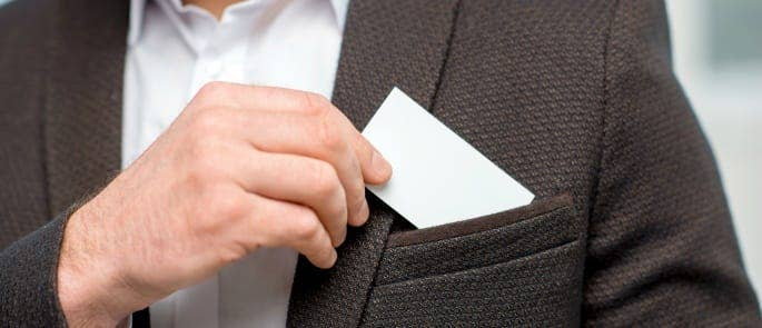 A man getting a business card out of his jacket pocket