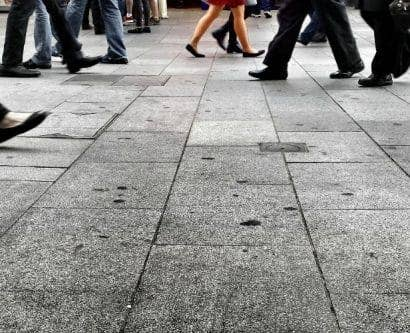 image of people walking on the pavement