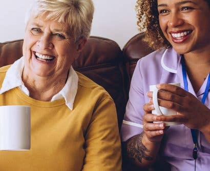 carer having cup of tea with service user and friend