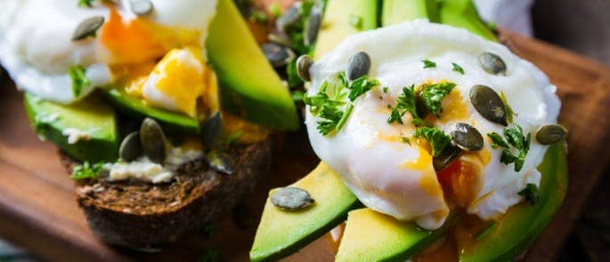 Avocado on toast with poached egg and sunflower seeds