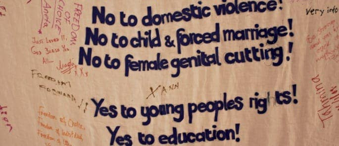 FGM protest banner