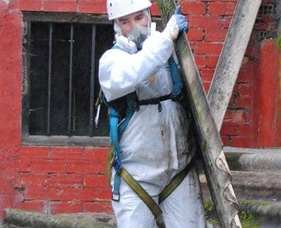 workers handling pipes with asbestos