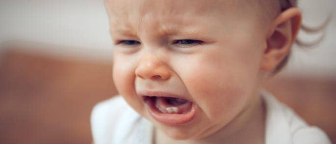 A young baby girl crying