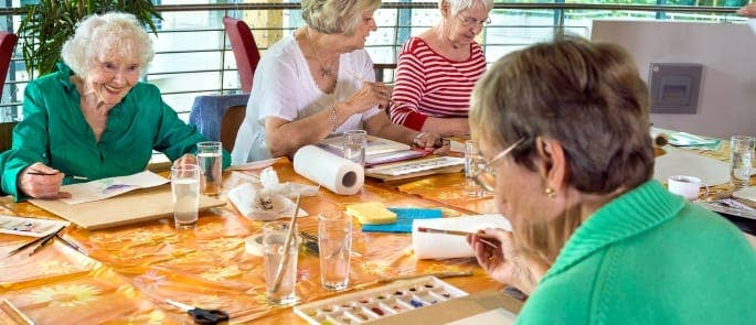 Care home patients engaging in social activities