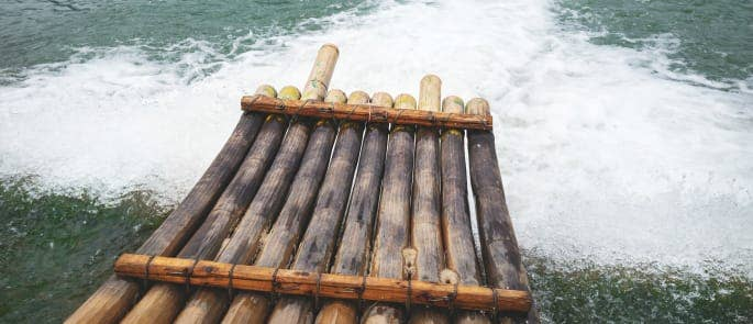 A bamboo life raft on choppy waters