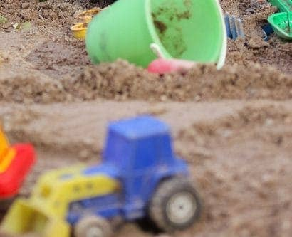 child's sandpit with toys
