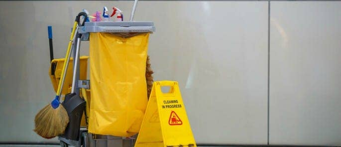 A clean up kit for cleaning spills and preventing slips, trips, and falls