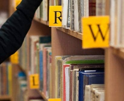 girl looks at books in library