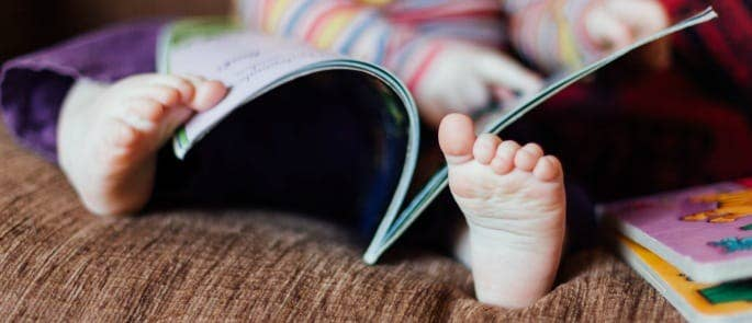 A little girl being read to