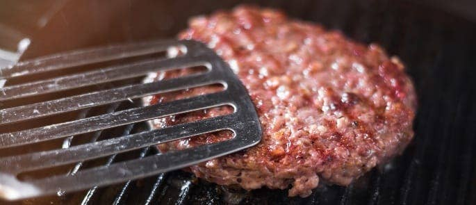 Cooking a medium cooked burger on a grill