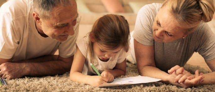 Parents watching their child with dyslexia write