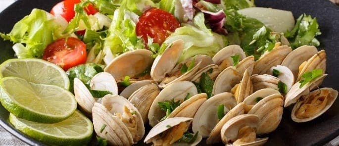 A salad served with clams