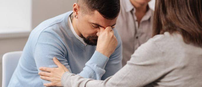 A stressed man in counselling