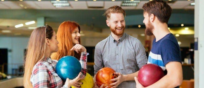 Colleagues socialising at a bowling alley