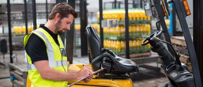 Responsible person inspecting work warehouse vehicle