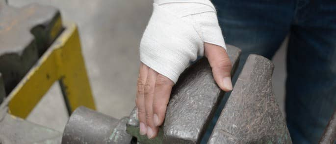 Worker with a hand bandage after a workplace injury