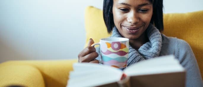 woman drinking tea and reading book