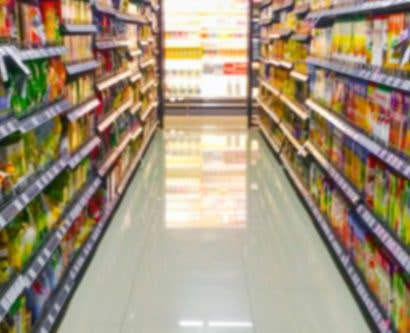 supermarket aisle with labelled products