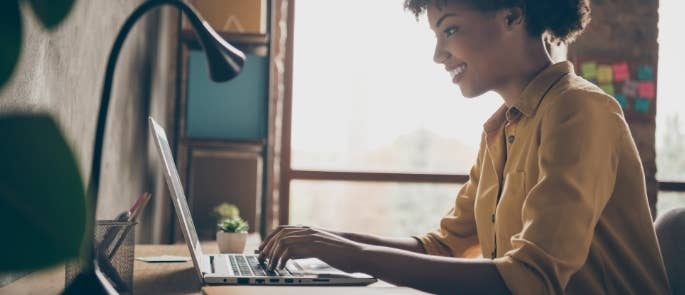 Woman with laptop working from home